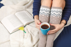 Female legs in warm woolen socks.